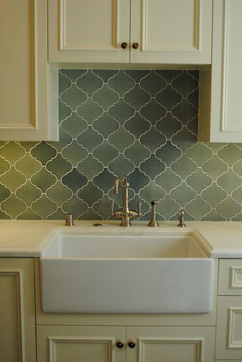 cream cabinets brass hardware green arabesque tile backsplash