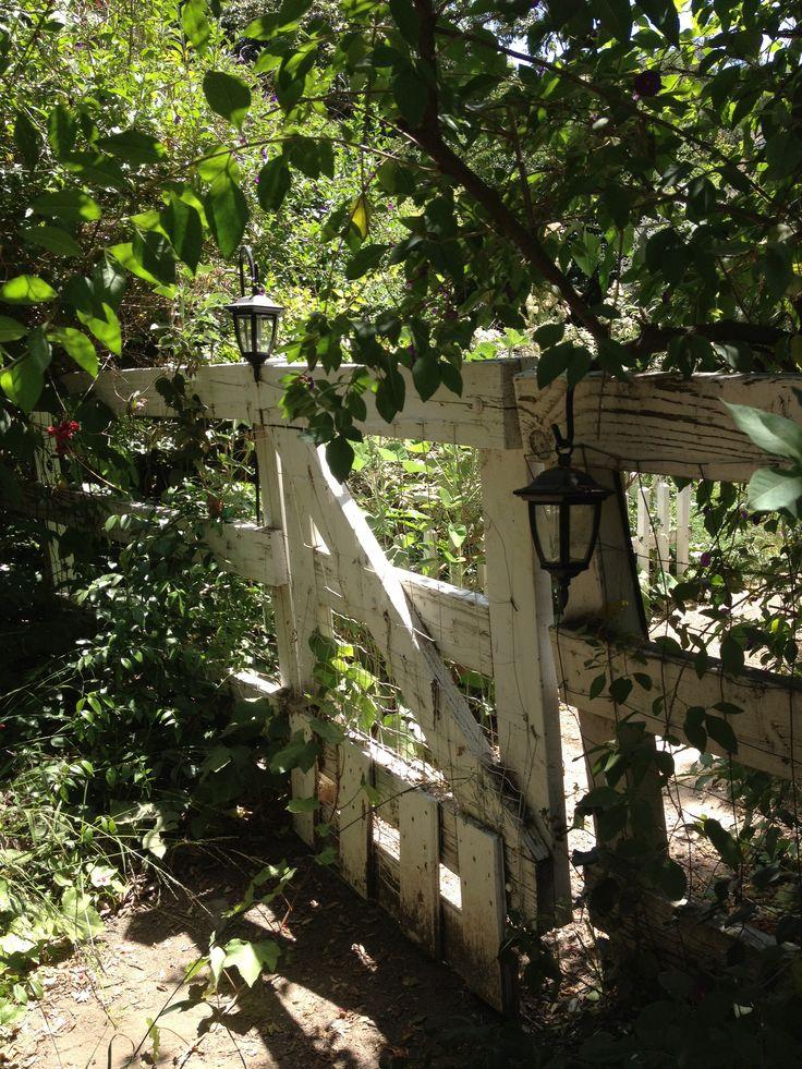 Rustic garden gate with lanterns garden design for Rustic garden gate designs