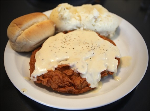 country fried steak, with white gravy and mashed potatoes