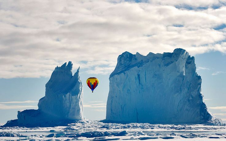 Fly by: This photo was taken on the ice near Arctic Bay last month. As far as we know, it is the highest latitude passenger flight on a hot air balloon ever. It was quite the sight to see a hot air balloon fly between the iceberg columns -- it is one iceberg but looks like two. (© Michelle Valberg/National Geographic Traveler Photo Contest)  In Focus - The Atlantic
