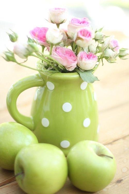 Flowers in polka dot green pitcher.