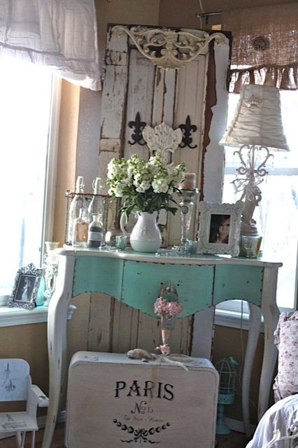 A Sort Of Fairytale: Blog- gorgeous table in turquoise and white. I love the old peeling door used as art for this space. Of course, its all put together so soothingly, with the dreamy turquoise against various shades of white. Ummmm, how yummy.