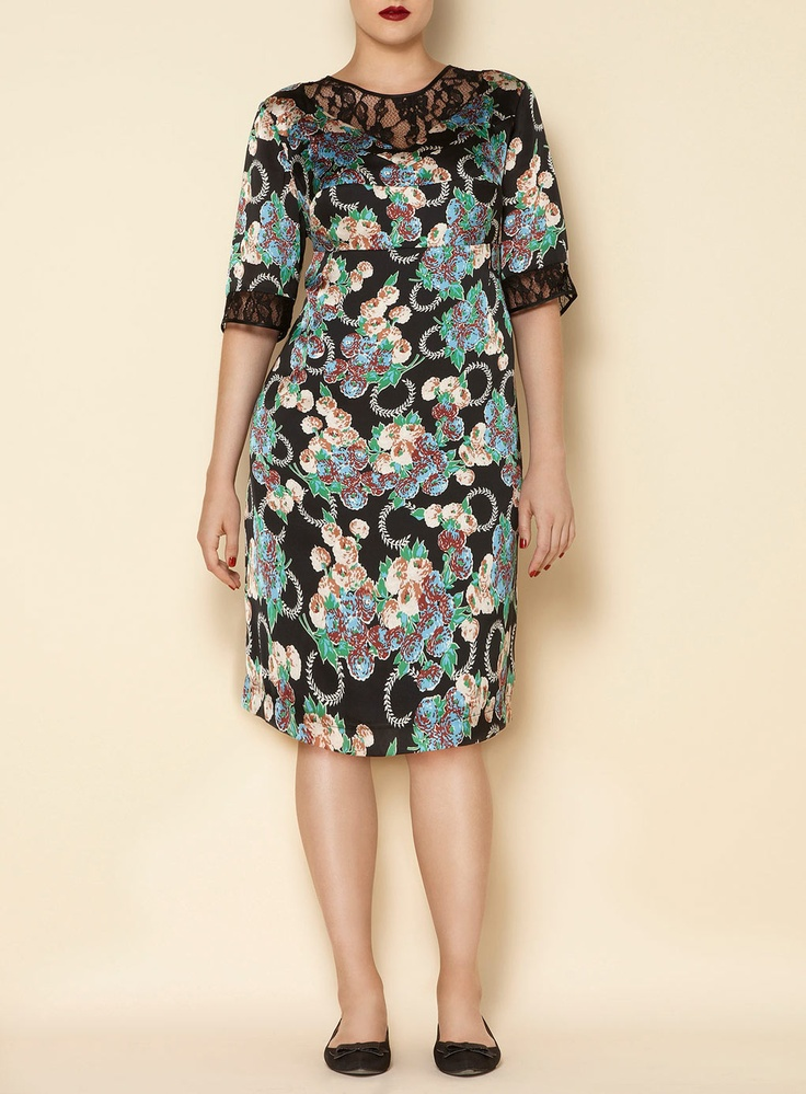 """Swan by Clements Ribeiro Wisteria 21 dress in black silk-like satin and lace inserts at neck and cuff, in all over wisteria print and ¾ length sleeves. Length: 107cm (42""""). Machine washable. 100% Polyester."""
