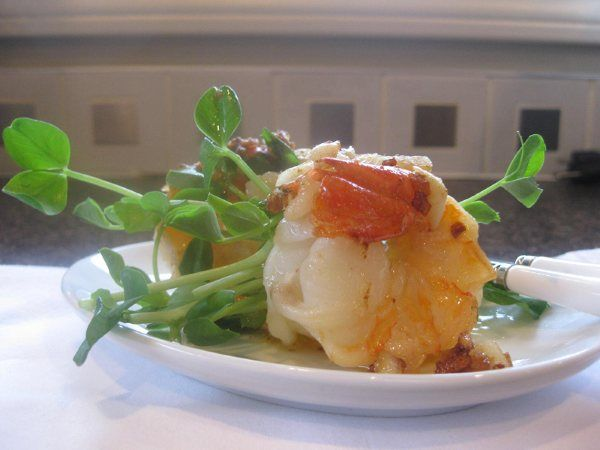 Prawns with Garlic Brown Butter and Pea Tendril Shoots.