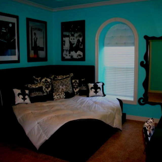 tiffany blue bedroom with our black bed and white down comforter