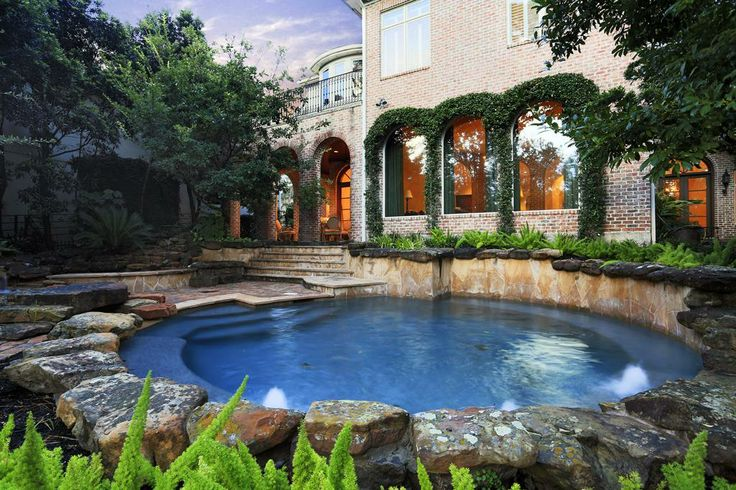 backyard descends in terraces to the bayou with stone stepped pathways