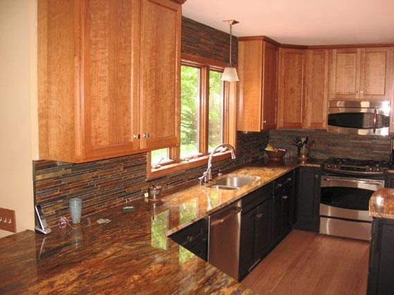 Featured here, we have cherry Concord Showplace cabinets with Sienna