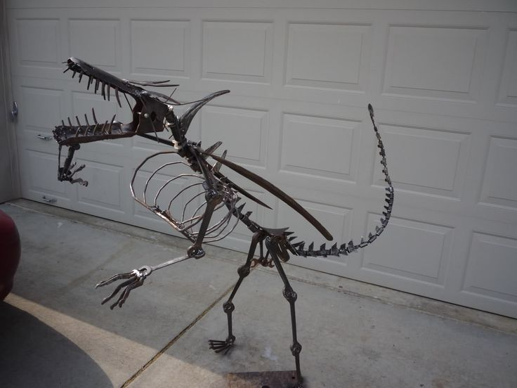 metal sculptures, mostly made from old tools, wrenches, post hole diggers.