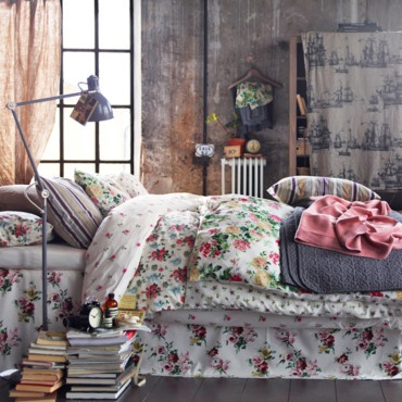 Floral bedding and books for a nightstand