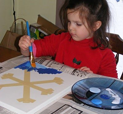 Snowflake watercolor art -- make snowflake with masking or blue tape and let the painting begin!  #kids craft