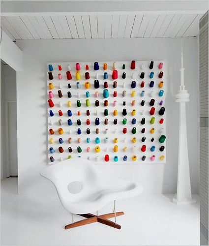 Douglas Coupland's home, Vancouver: Spools of thread are on display as they would be in a tailor shop... when guests come over, Mr. Coupland invites them to pull on the string.