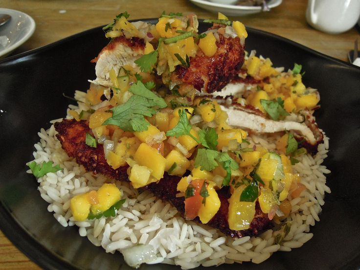Coconut breaded chicken with citrus & thyme rice and mango salsa, at ...