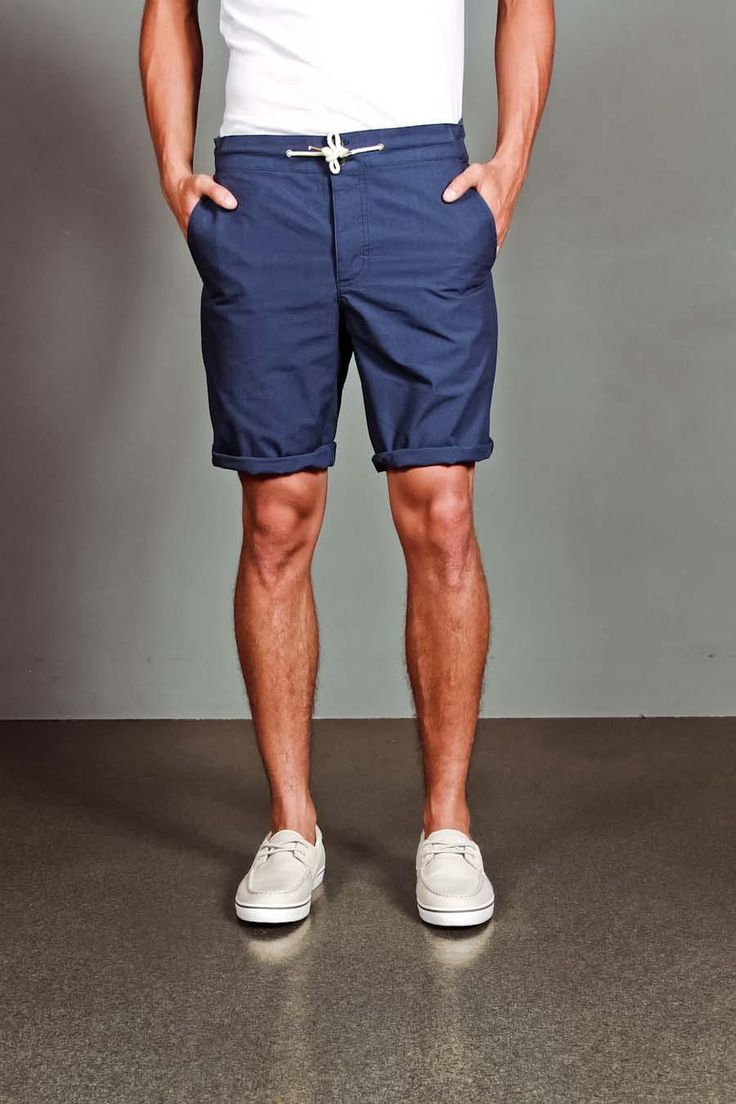 Blue drawstring rolled-cuff shorts with tucked in white tee