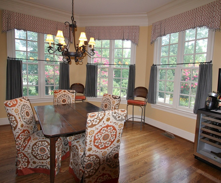 Pleated valances with glass bead trim, gray linen cafe curtains, slipcovered Parson chairs