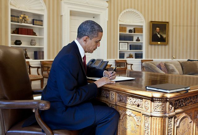 President Obama's DODOcase sharing the desk in the oval office.
