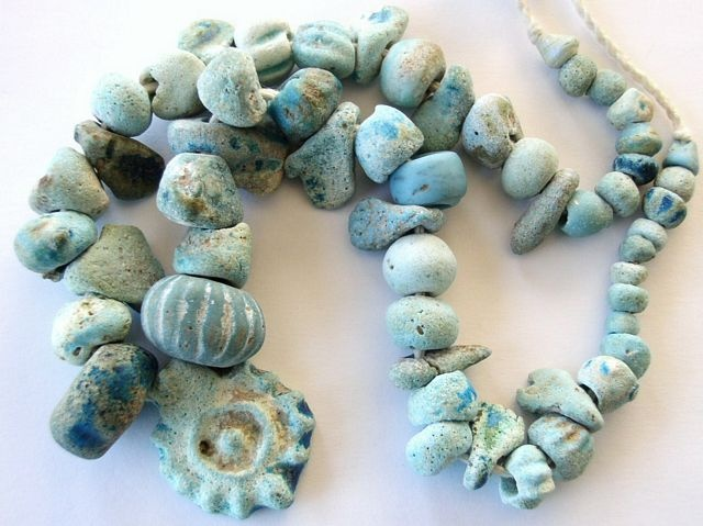 Ancient faience beads that were found during excavations in Afghanistan |  Date back to approximately 700 BC.