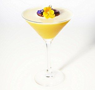 The Corrie Nielsen cocktail at the May Fair Hotel.    Inspiration: Corrie Nielsen's SS13 show is based around the blueprints of flowers and botanics. Her colours for the season are: muted oranges and yellows.    Grey Goose vodka  Rose petal water  Passionfruit juice  Gomme syrup  Fresh passionfruit and edible flower garnish