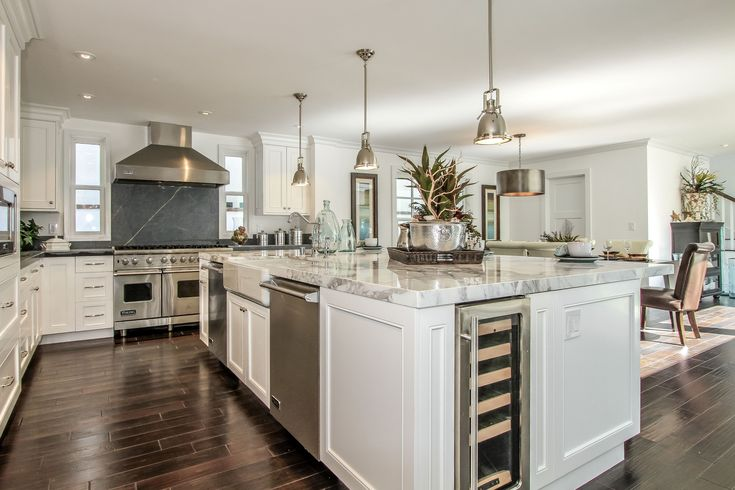 Wine cooler and an island with calcutta marble countertops 119 via