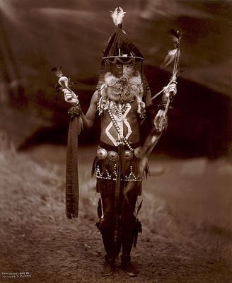 Shaman:  #Shamans and Medicine Men secure the help of the spirit world, including the Great Spirit, for the benefit of the community, curing diseases, and performing important ceremonies. A Diné man, full-length, in ceremonial dress, including mask and body paint,  1904 photo by Edward S. Curtis.
