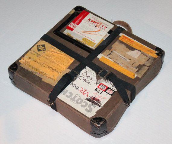 old movie reel case with 3 reelsl slots