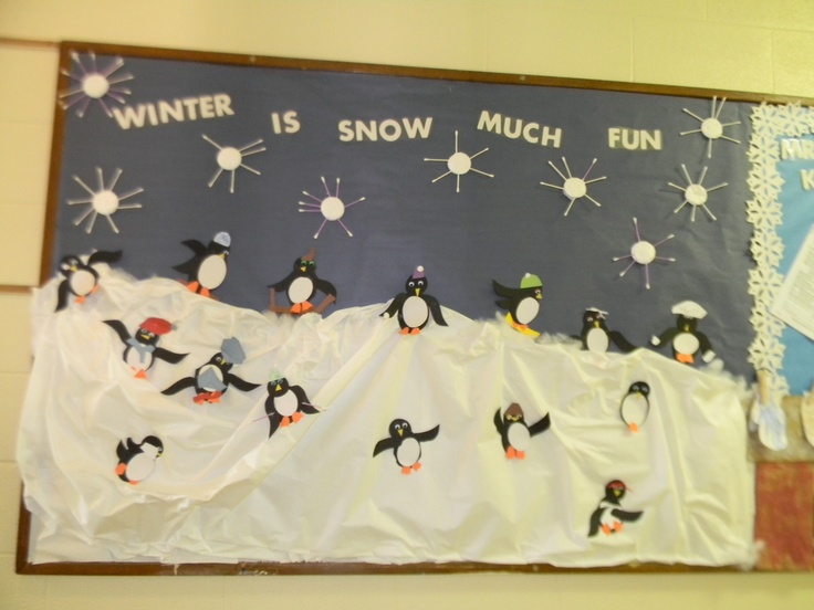 Playful penguin bulletin board snowflakes are made from cotton swabs