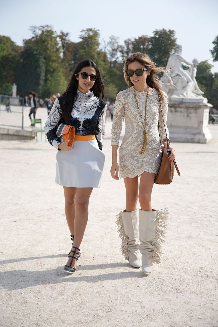 "Paris Fashion Week Street Style – Spring/Summer 2014 (Vogue.com UK)Nausheen Shah, writer, and Erica Pelosini, editor  Nausheen: ""I'm wearing Delirious sunglasses with a Georgina Hardinge top and skirt, Valentino shoes, a Khir Ma Elzov clutch and Annelise Michelson rings.""   Erica: ""I'm wearing Celine sunglasses with an Isabel Marant dress and boots, and a vintage Givenchy bag."""
