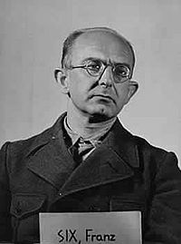 Dr. Franz Alfred Six (12 August 1909 in Mannheim - 9 July 1975 in Bolzano) was a Nazi official who rose to the rank of SS-Brigadeführer. He was appointed by Reinhard Heydrich to head department Amt VII, Written Records of the Reichssicherheitshauptamt (RSHA). In 1940, he was appointed to direct state police operations in an occupied Great Britain following invasion.