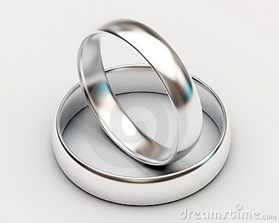 Platinum wedding rings on white background by Rasslava, via Dreamstime