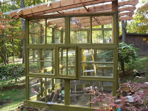 Greenhouse built from salvaged windows green thumb for Reclaimed window greenhouse