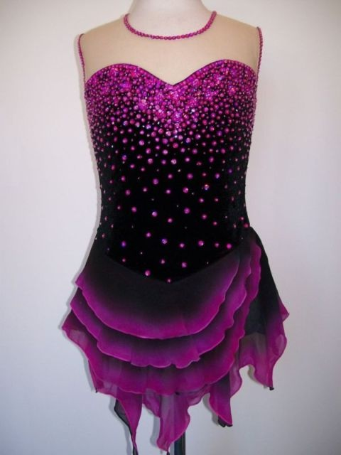 Pretty!  Colored crystals & dyed skirt on black ground