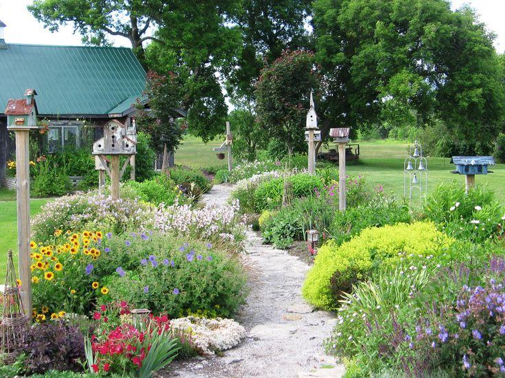 Birdhouses along pathway in Ontario garden.