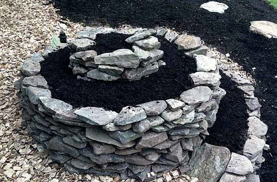 Make an Herb Spiral! The ultimate raised bed... from Edible Landscaping with a Permaculture Twist by Michael Judd