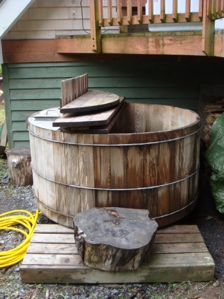 Rustic wood fired hot tub wood fired hot tubs pinterest for Wood burning spa