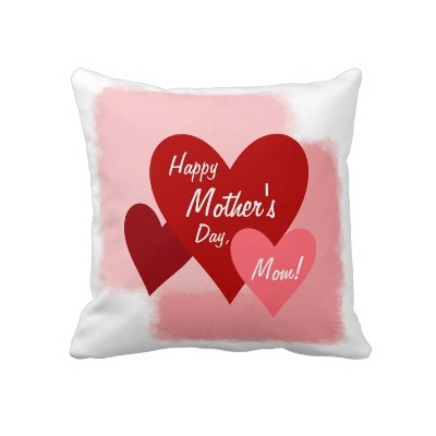 Throw pillow with three red and pink hearts over pink textures. The front includes the words Happy Mother's Day, Mom!