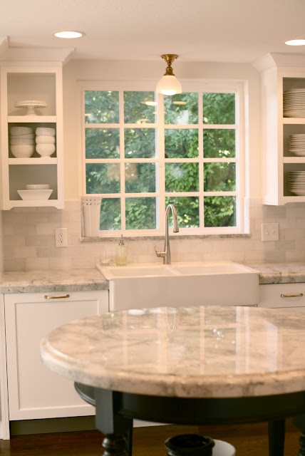 sink wall...open uppers, window, sink, faucet, white granite...