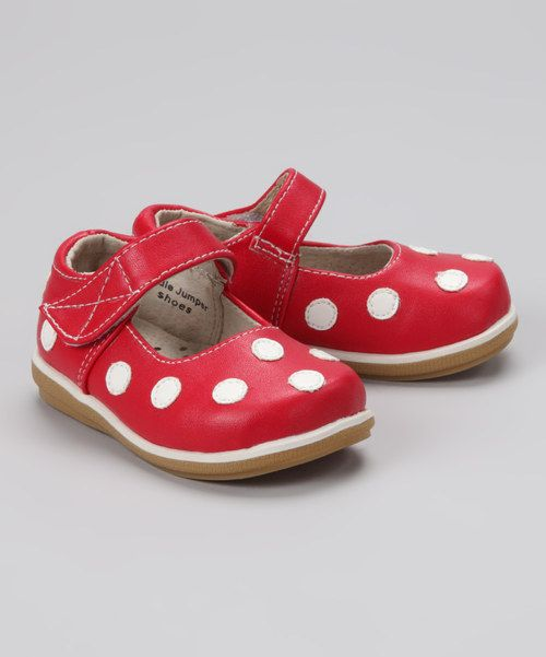 Polka dots are on parade atop these darling mary janes. Lined inside