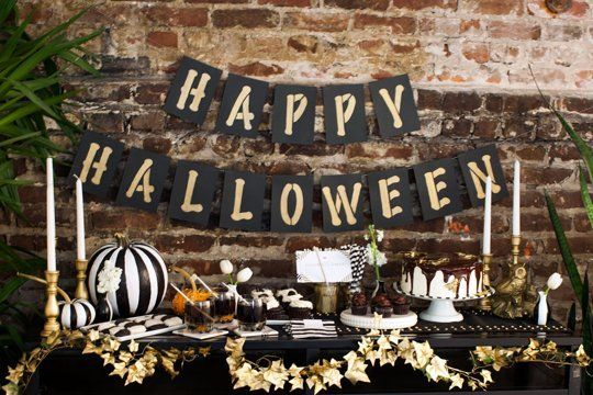 A Chic Halloween Table in Black, White, & Gold — Brit + Co. | Apartment Therapy