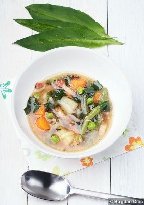 Spring vegetable soup finished with wild garlic