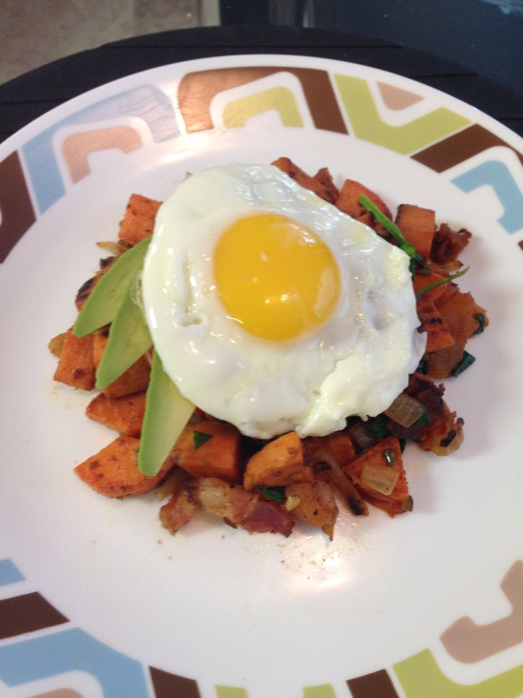 Sweet potato, carrot, onion, bacon and spinach hash topped with sliced ...