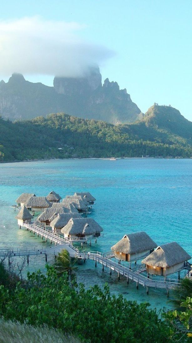 Tahiti bungalows over the water - Courtesy of media-cache-ec0.pinimg.com