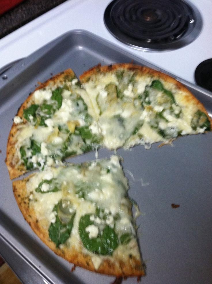 ... pizza crust, basil pesto, artichoke hearts, mozzarella, goat cheese