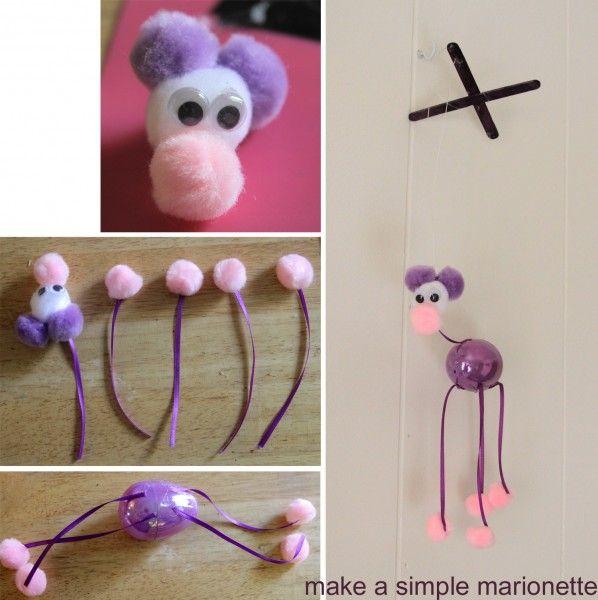DIY easy marionette: plastic easter egg, ribbon and pom poms