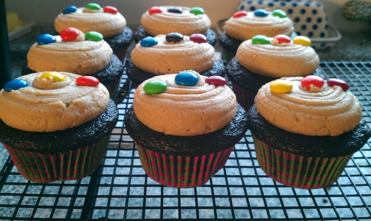 Dark Chocolate cupcakes filled with peanut butter MnM cookie dough topped with peanut butter cookie dough buttercream!!!