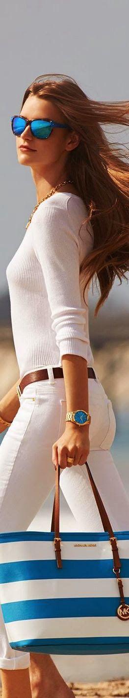 white sweater white pants and handbag