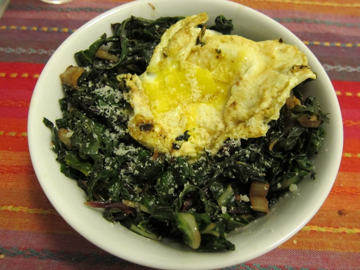 Greens (unindentified ones) over polenta with fried egg and parmesan