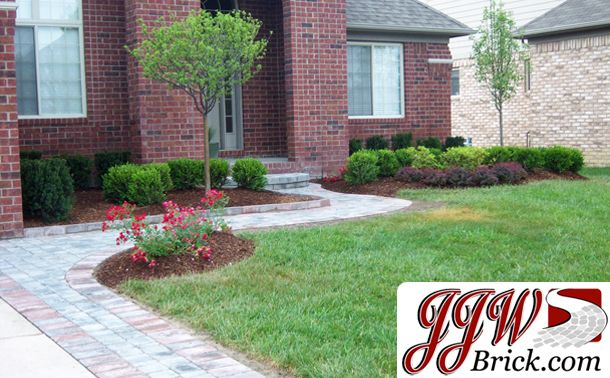 front yard landscaping design idea for ranch style home in
