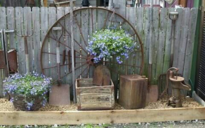 Wagon wheel landscape and more pinterest for Things to do with old wagon wheels