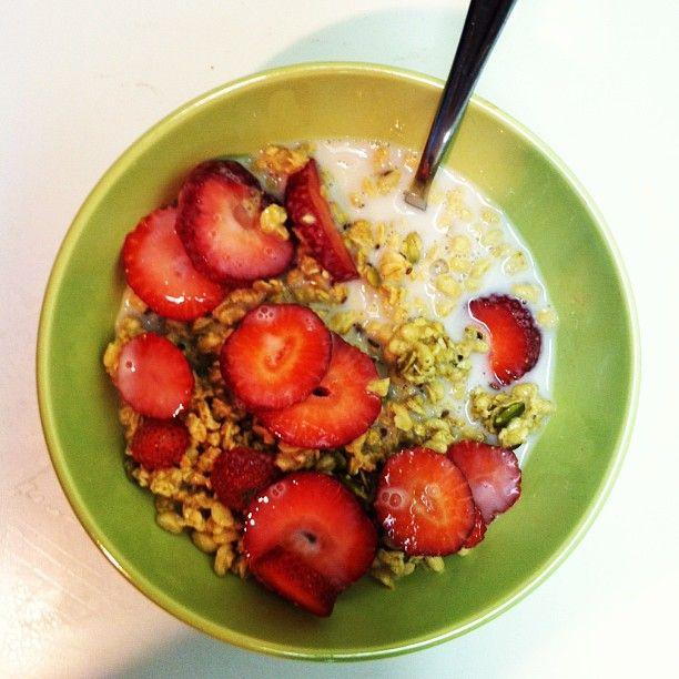 Hemp granola, fresh strawberries, almond milk.