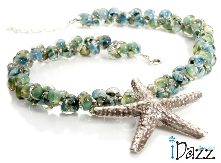Handmade seaglass colored beads with a pure silver pendant....this just says summer!  http://www.idazz.com/product.asp?pid=397