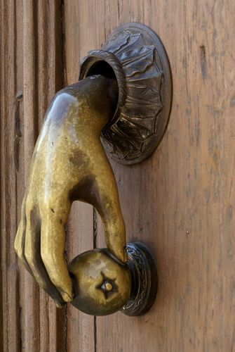 DOOR KNOCKER:  Hand knocker...its kind of creepy...but I like it